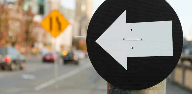 Directional arrow points toward split lanes