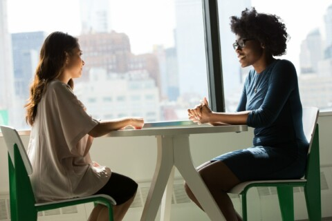 One woman interviewing another
