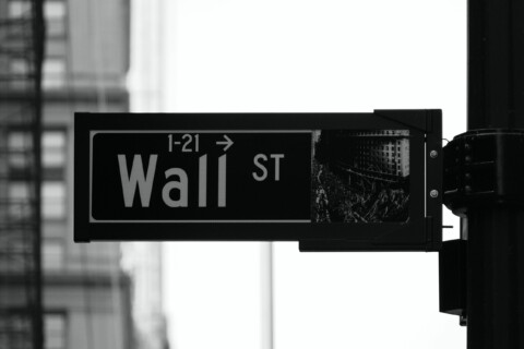 Black and White photo of the wall street street sign
