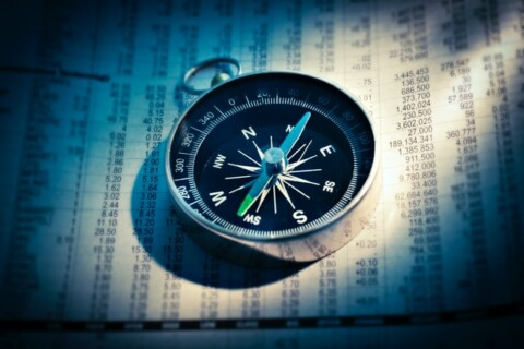 compass resting on spreadsheet