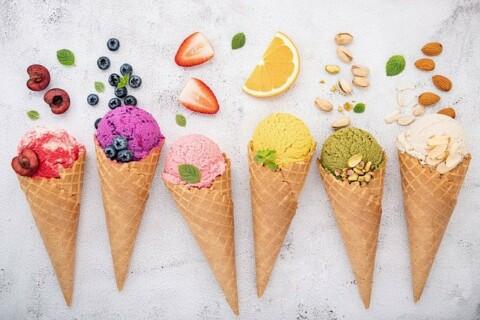 six ice cream cones featuring different flavors