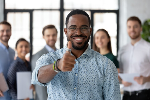 Loyal Black Male Client Demonstrating Thumb Up Recommending Good