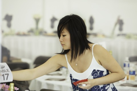 image of a wedding planner setting up an event
