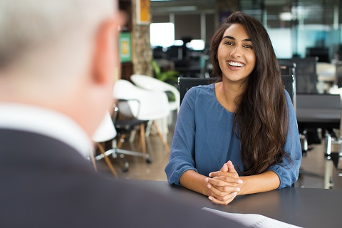 Young,Female,Candidate,Laughing,At,Job,Interview