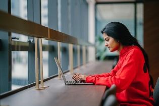 girl-Indian-asian-laptop-focused-shutterstock_1123965728-1