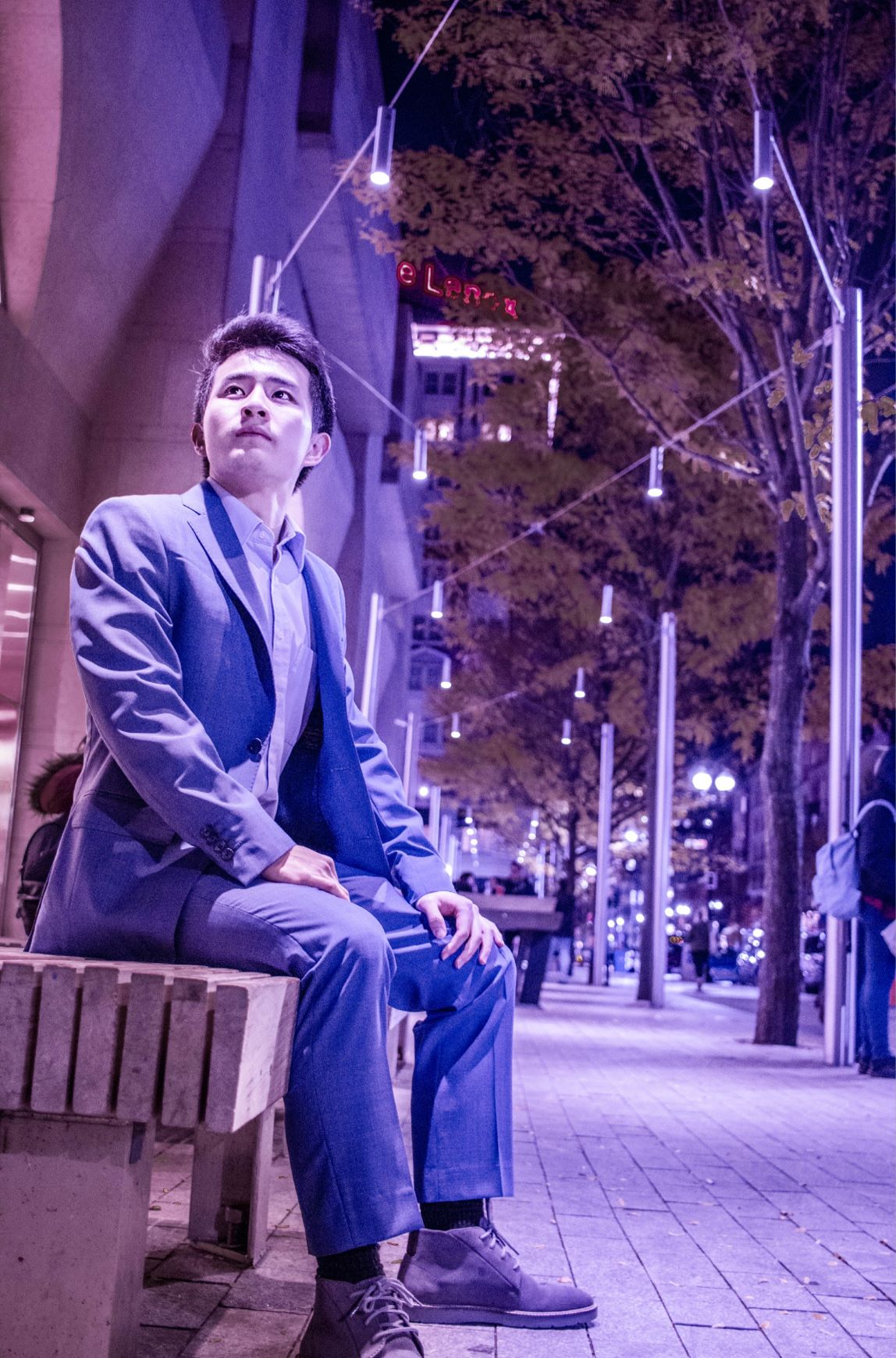 Shawn Shao sitting on bench