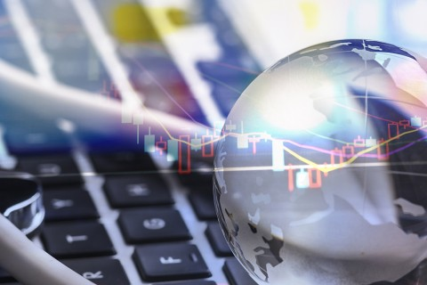 stock market data with computer and crystal ball