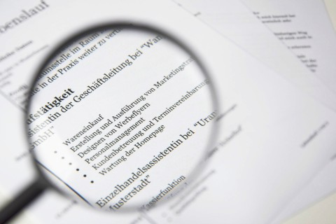 magnifying glass over resume/job description