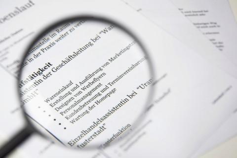 magnifying glass over resume/job description