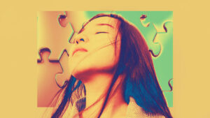 A long haired person with closed eyes appears against a puzzle piece background
