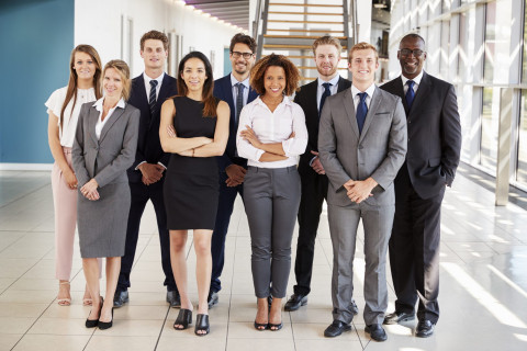 group of professionals standing posed