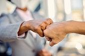 fist bump between professionals