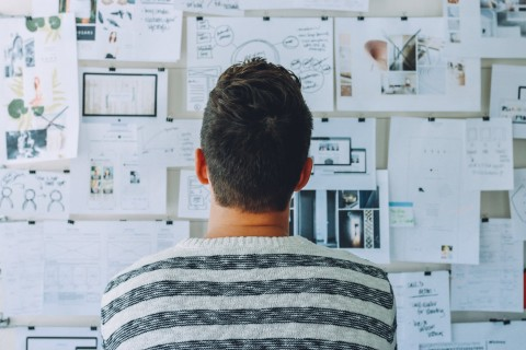 person looking at designs creative decisions working