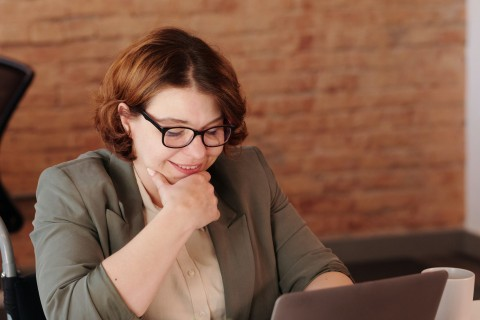 photo-of-woman-smiling-while-using-laptop-4064178