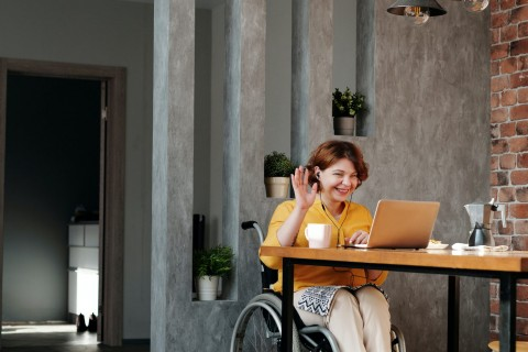 woman-in-orange-tank-top-sitting-on-black-wheelchair-4064696