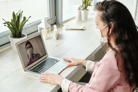 Wearing masks and using video on laptop