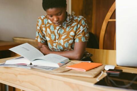 diverse person reading book