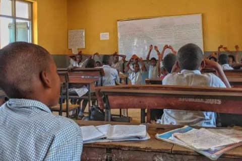 teacher teaching a group of students