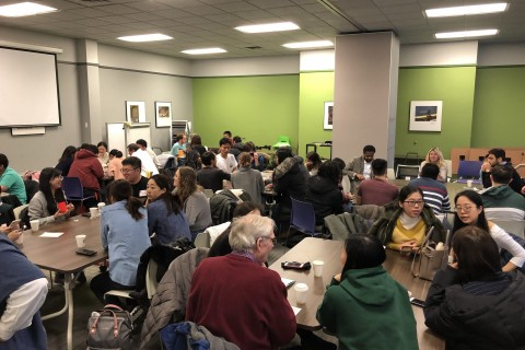 Groups talking at individual tables in a crowded room