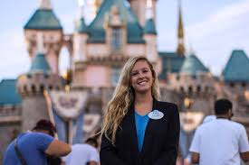 Professional woman standing in front of a building at Disney World
