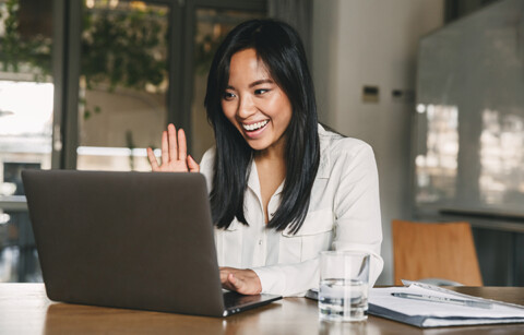 Image of happy asian woman 20s wearing white shirt smiling and w