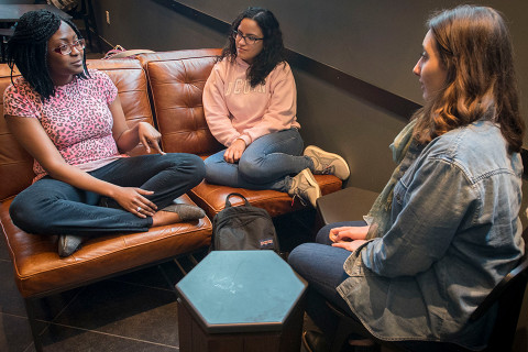 Students having a conversation at the UConn School of Social Work.