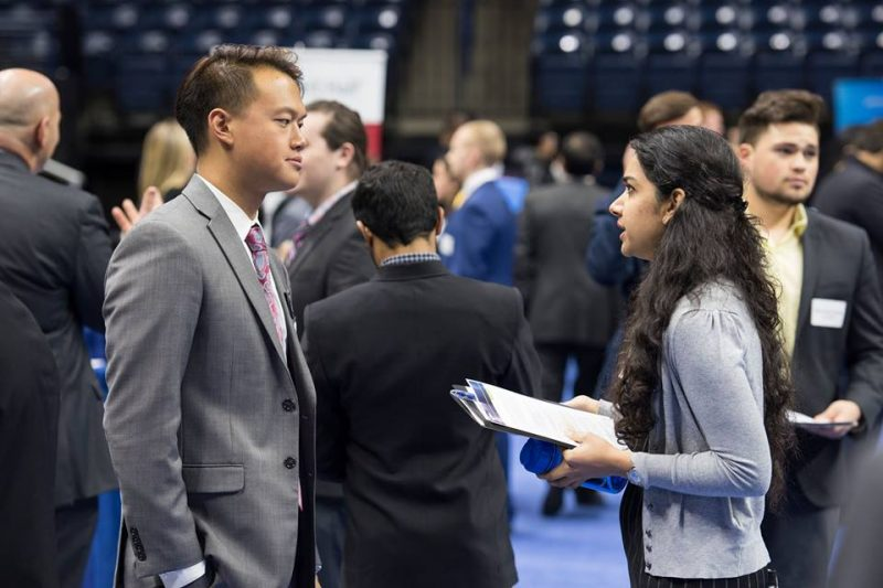 Student and Employer talk at the STEM Career Fair