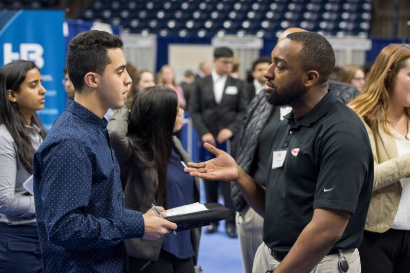 Student and Employer talk at the All-University Career Fair