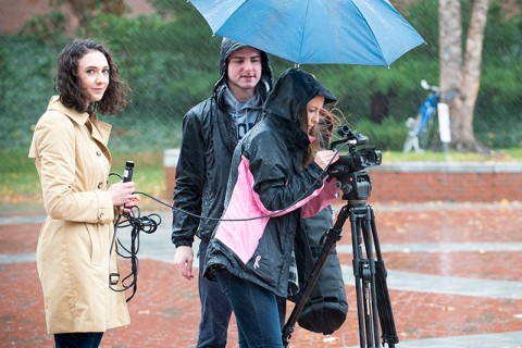 UCTV working on a video in the rain.