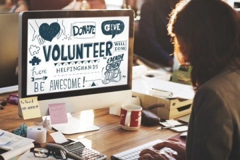 A virtual volunteer doing graphic design work.