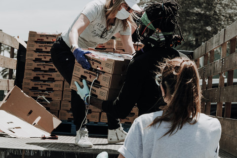 Volunteers delivering produce.