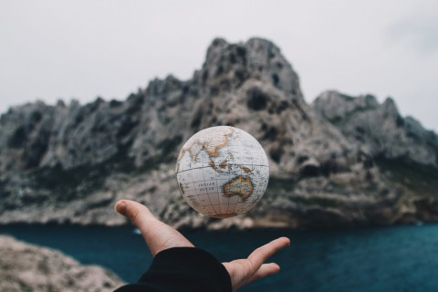 person-tossing-globe-1275393