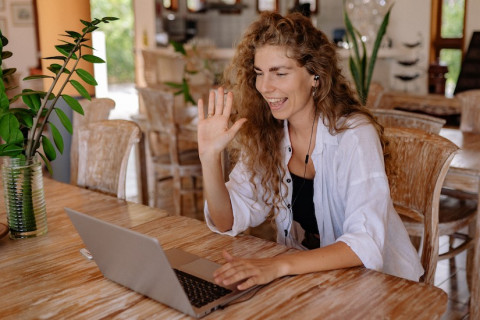 woman-in-white-shirt-sitting-on-chair-in-front-of-macbook-4458421-1