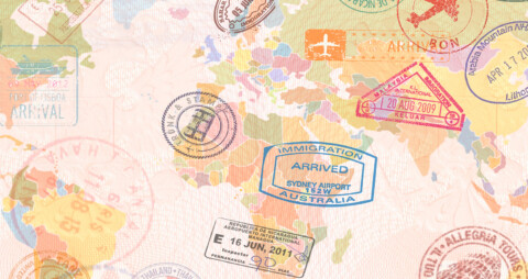 World map with passport stamps on several countries