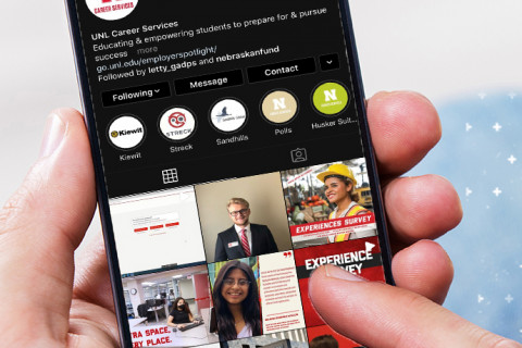 Mobile phone with Career Services Instagram account shown on screen