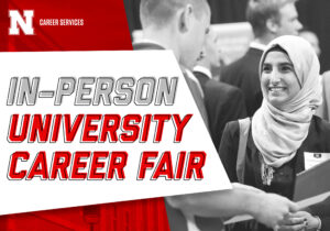 Female student talking to employer at career fair