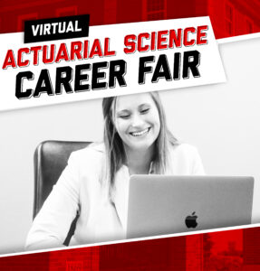 Female in business attire in front of laptop attending virtual career fair